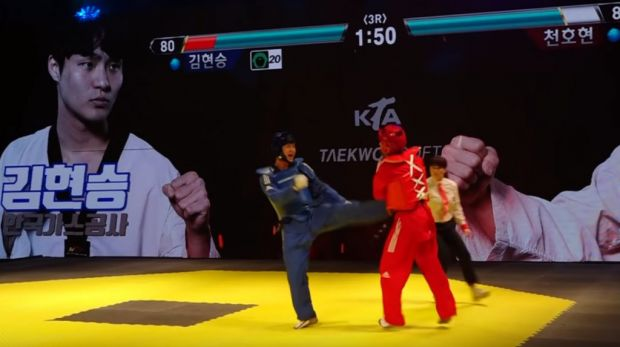 taekwondo-match-turns-into-irl-tekken-with-health-bar-and-sound-effects